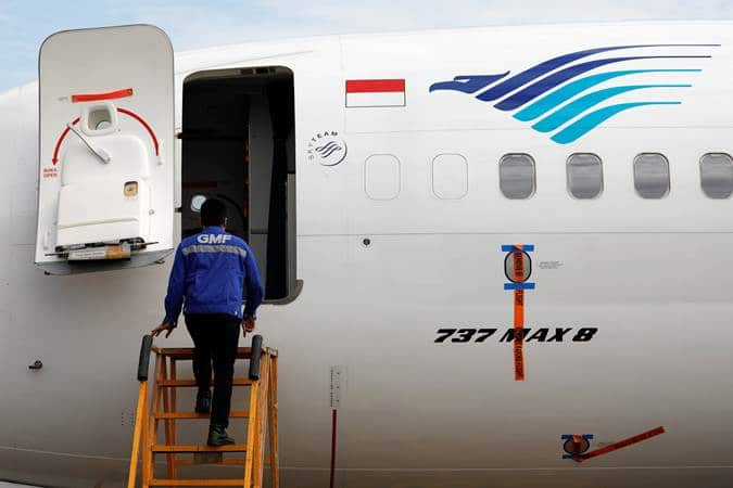 A technician prepares to check Garuda Indonesia's Boeing 737 Max 8 airplane parked at the Garuda Maintenance Facility AeroAsia, at Soekarno-Hatta International airport near Jakarta, Indonesia, March 13, 2019. REUTERS/Willy Kurniawan