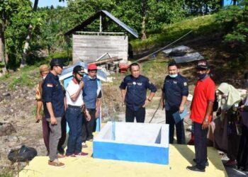 Sekda Ridwan Yasin Uji Fungsi Program Pamsimas di Dumolodo, Kecamatan Gentuma Raya, Jumat (4/12/2020)