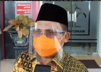 Wali Kota Gorontalo, Marten Taha, saat diwawncarai awak media usai menerima penghargaan Daerah Peduli HAM di kantor Kanwil Kemenkumham Gorontalo, Senin (14/12/2020).