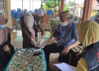 Lahmuddin Hambali saat lakukan tes skrining. Selasa, (02/02/2021). (Foto : Istimewa).