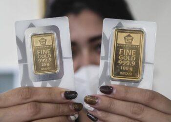 Ilustrasi Kepingan Emas (Foto : Antara/Galih Pradipta).