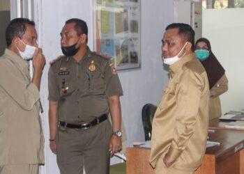 Hendra Hemeto, saat melakukan kunjungan di sejumlah OPD Kabupaten Gorontalo. (Foto : Istimewa).