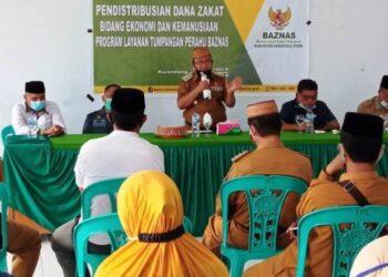 Bupati Gorontalo Utara, Indra Yasin menyampaikan sambutan dalam acara Baznas Gorontalo Utara. (foto:prin)