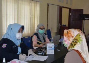 Kegiatan Screening yang dilakukan pada Vaksinasi Covid-19 di Dinas Pariwisata Provinsi Gorontalo