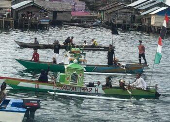Pawai perahu menyambut Idul Fitri 1442 H, oleh masyarakat Pagimana. (Foto : Istimewa)