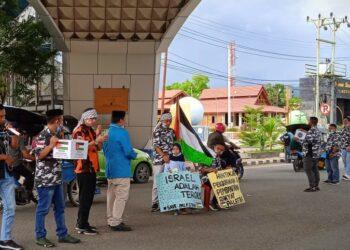 Aksi galang dana untuk Palestina oleh 3 Organisasi Kepemudaan di Kabupaten Gorontalo. (Foto ; Istimewa)