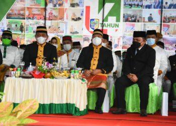 Wabup Hendra Hemeto (kanan) menghadiri HUT Bolmut ke 14. (Foto : Istimewa)