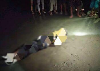 Mayat di temukan warga tergeletak di pesisir pantai Tolinggula. (Foto : Istimewa)